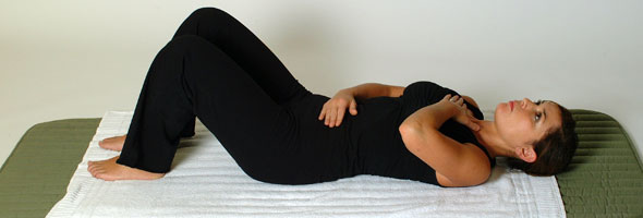 Picture of Woman lying down, doing pilates